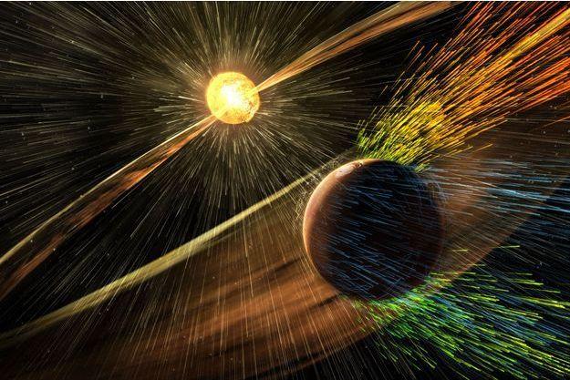 Illustration d'une éruption solaire qui atteint la planète Mars.