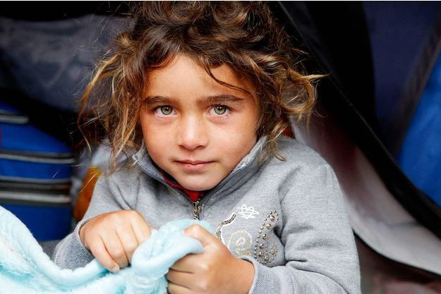 Photo d'illlustration. Bidonville installé à Lyon sous le pont d'une autoroute en 2013. Parmi les 200 Albanais, 60 enfants et 20 adolescents.