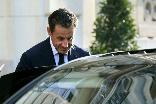 Nicolas Sarkozy sortant de son audition avec le juge Gentil en mars dernier.