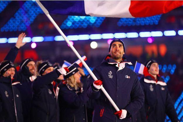 Martin Fourcade était le porte-drapeau de la délégation française lors de la cérémonie d'ouverture des JO de Pyeongchang.