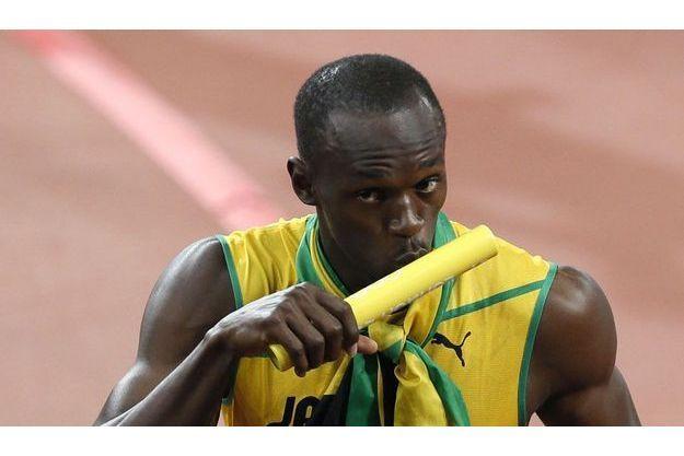 Usain Bolt aurait bien aimé garder en souvenir le bâton du relai 4x100 m.