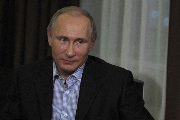 Vladimir Poutine en interview à Vladivostok en Russie le 13 novembre 2014.
