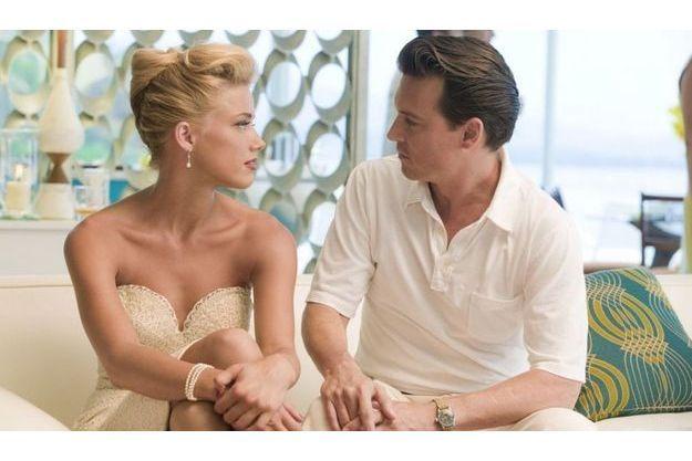 "Amber Heard et Johnny Depp dans ""Rhum Express""."