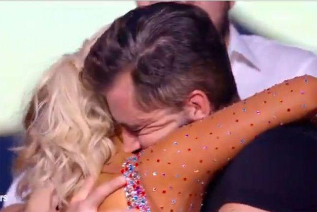 """Olivier Minne et sa danseuse Katrina Patchett après l'annonce de leur élimination samedi, sur le plateau de """"Danse avec les stars""""."""