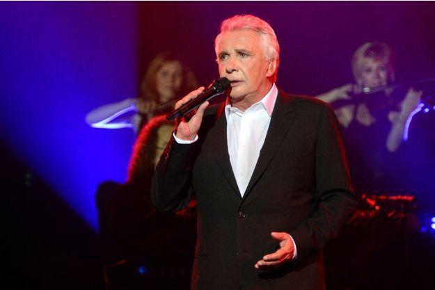 Michel Sardou sur scène en juin dernier.