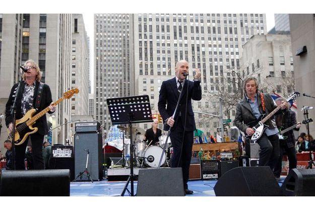 Mike Mills, Michael Stipe, Peter Buck en concert à New York en 2008.