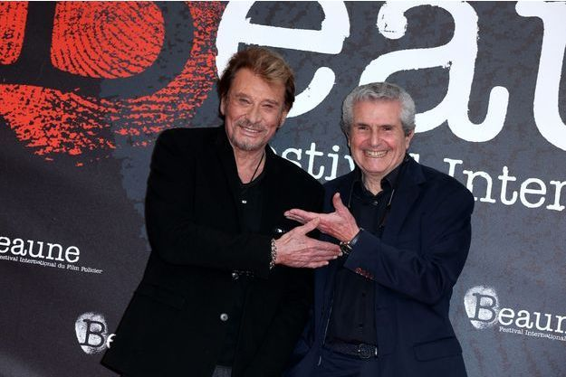 Johnny Hallyday et Claude Lelouch lors de la soirée d'ouverture du 6ème Festival International du Film Policier de Beaune avec un hommage à Johnny Hallyday pour l'ensemble de sa carrière cinématographique, le 2 avril 2014.