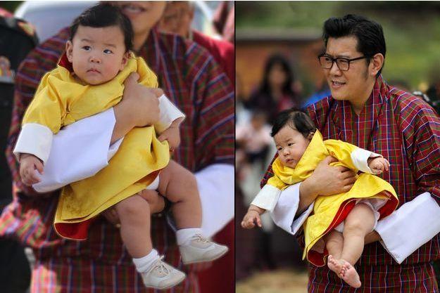 Le prince Jigme Namgyel Wangchuck dans le bras de son père le roi du Bhoutan à Chamkhar, le 9 août 2016