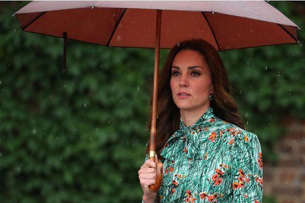 Kate Middleton lors de sa dernière apparition publique avant l'annonce de sa troisième grossesse, le 30 août 2017.