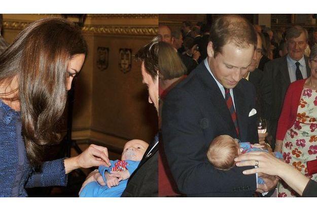Kate et William avec le bébé à la soirée en l'honneur de la Légion.