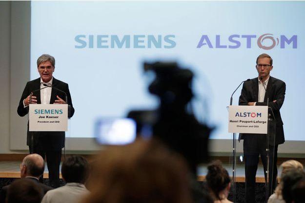 À gauche, Joe Kaeser, directeur général de Siemens et Henri Poupart-Lafarge, directeur général de Alstom.