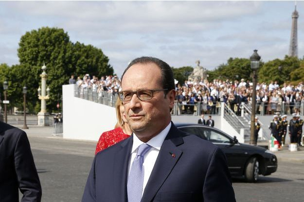 Le président Francois Hollande lors du défilé sur les Champs-Elysée, le 14 juillet 2015.