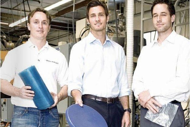 Mark Herrema, au centre, avec deux collaborateurs.