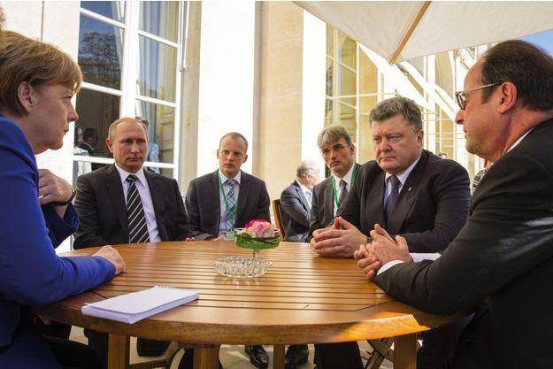 Les dirigeants allemand, russe, ukrainien et français – Angela Merkel, Vladimir Poutine, Petro Porochenko et François Hollande – réunis le 2 octobre 2015 à Paris pour trouver une issue au conflit ukrainien.