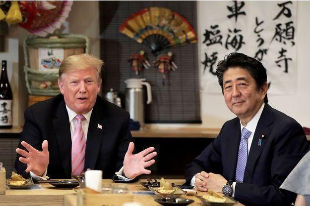 En visite au Japon, Trump relativise les tirs de missiles nord-coréens