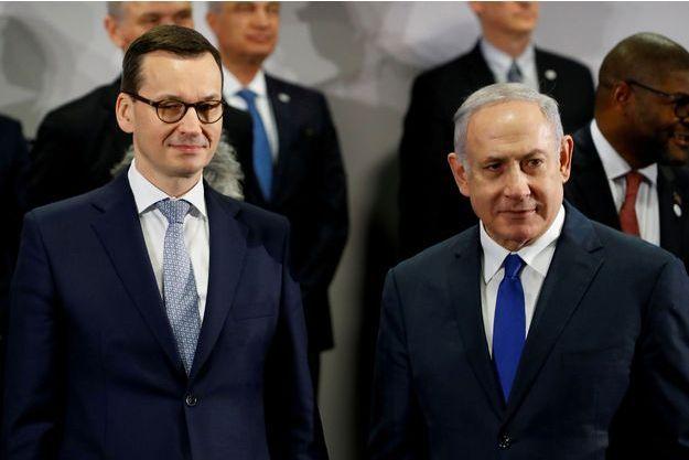 Les Premiers ministres polonais et israélien Mateusz Morawiecki et Benjamin Netanyahu.