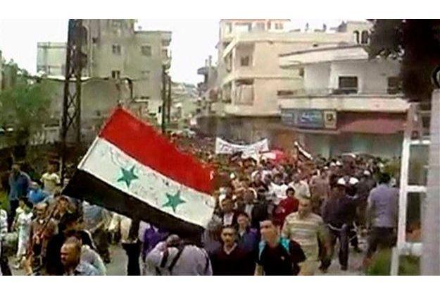 Une marche à Homs en Syrie, le 6 mai dernier.