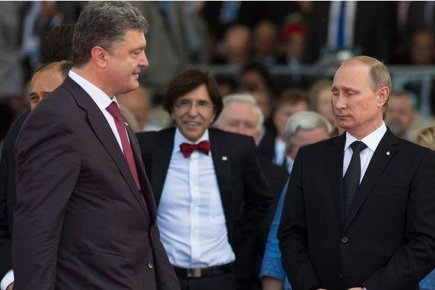 Vladimir Poutine et Petro Porochenko à Ouistreham le 6/06/2014 pour le 70e anniversaire du Débarquement en Normandie.