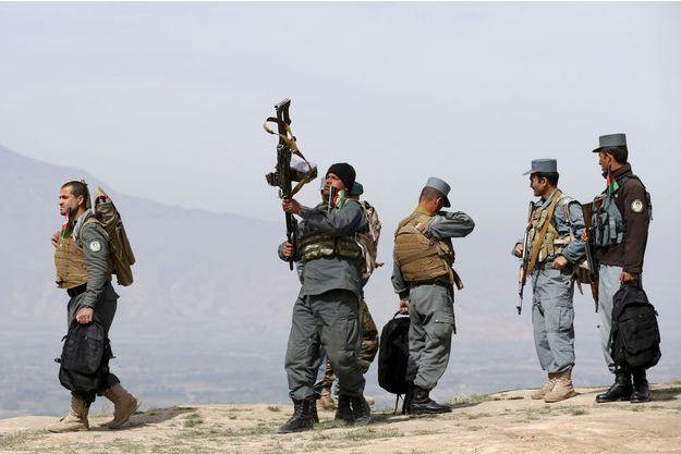 La police afghane en patrouille dans le district de Dand.