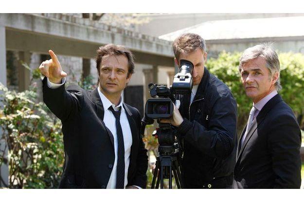 Le chanteur et le producteur avec leur cameraman sur les lieux du tournage de leur documentaire aux Etats-Unis.
