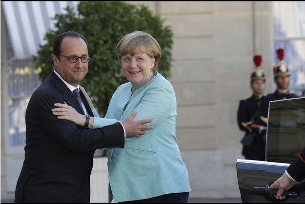 François Hollande et Angela Merkel à l'Elysée début juillet.