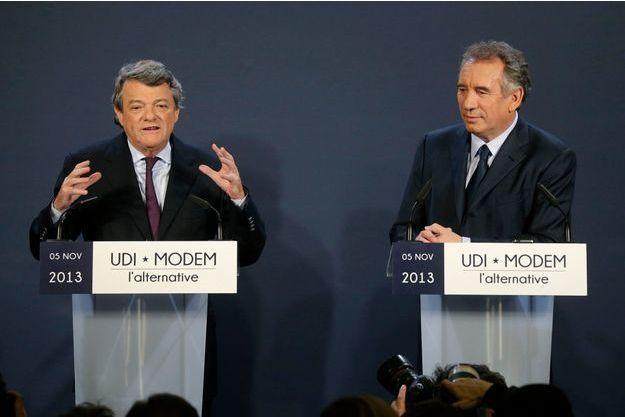 Jean-Louis Borloo et François Bayrou, ensemble à la Maison de la Chimie, à Paris, mardi.