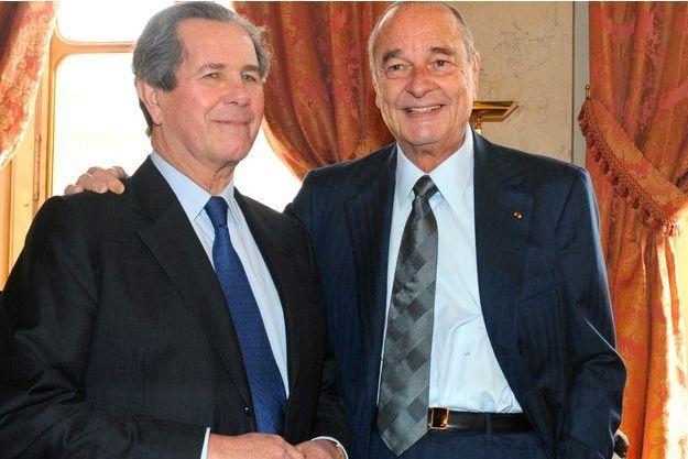 Jean-Louis Debré et Jacques Chirac au Conseil constitutionnel en 2009.