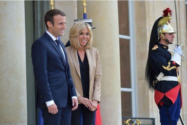 Emmanuel et Brigitte Macron, ici à l'Elysée en juillet dernier.