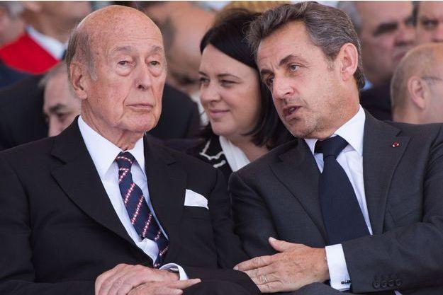 Valéry Giscard d'Estaing et Nicolas Sarkozy, à Ouistreham en 2014 pour l'anniversaire du Débarquement.