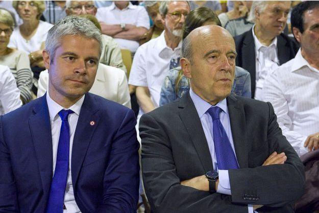Alain Juppé et Laurent Wauquiez, en juin 2016 lors d'un meeting en Haute-Loire.