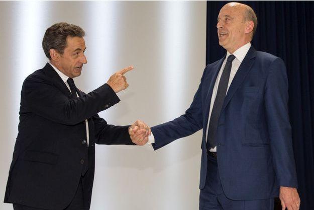 Nicolas Sarkozy et Alain Juppé, le 30 mai dernier.