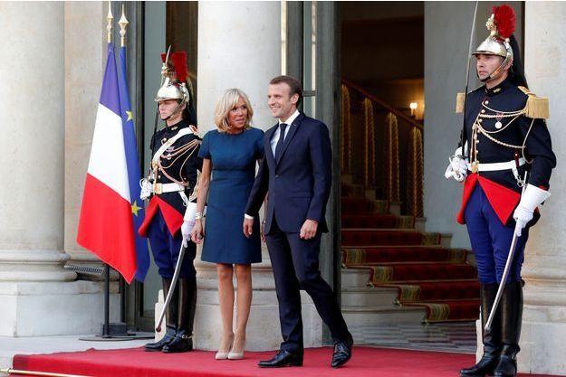 Emmanuel et Brigitte Macron à l'Elysée le 16 juillet.