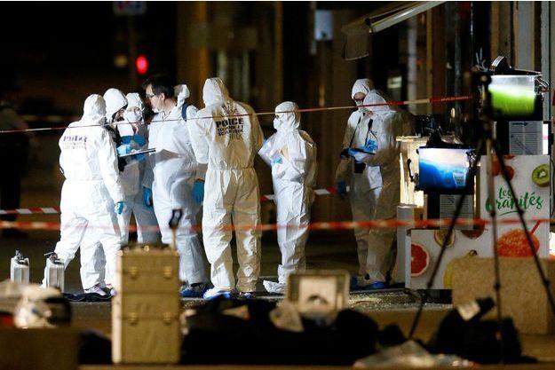 Les enquêteurs sur place, à Lyon, vendredi soir.