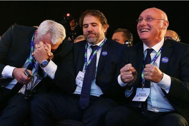 Claude Atcher, directeur de la candidature française pour la coupe du Monde 2023, Serge Simon, vice-président de la Fédération française de rugby et le président, Bernard Laporte à Londres le 15 novembre 2017