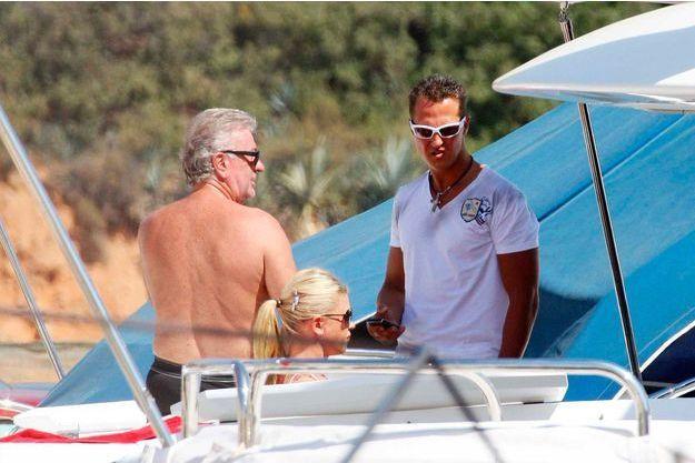Michael Schumacher, son épouse Corinna et son manager Willi Weber à Andratx, en 2009.