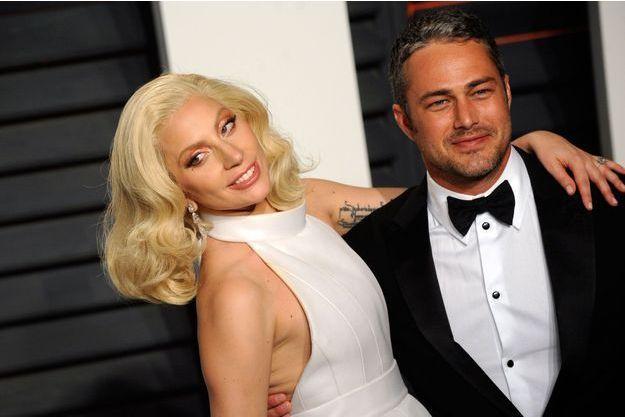 Lady Gaga et Taylor Kinney pour la 88ème cérémonie des Oscars, 2016.