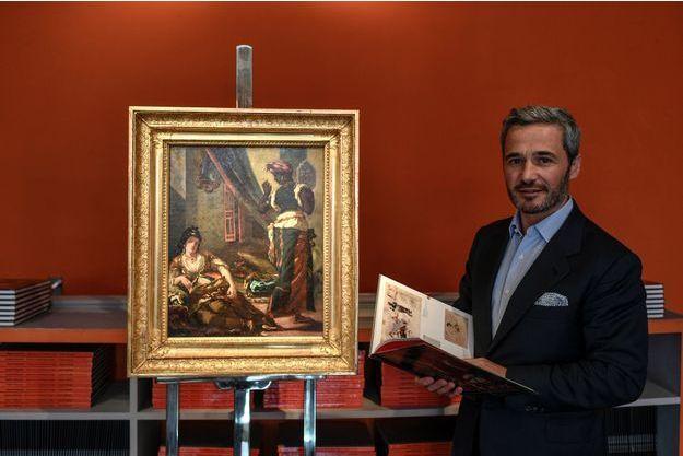 """Philippe Mendes présente le tableau """"Les Femmes d'Alger""""."""