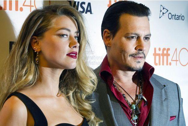 """Johnny Depp et sa femme Amber Heard à la première de """"Black Mass"""" au Festival international de film de Toronto le 14 septembre dernier."""