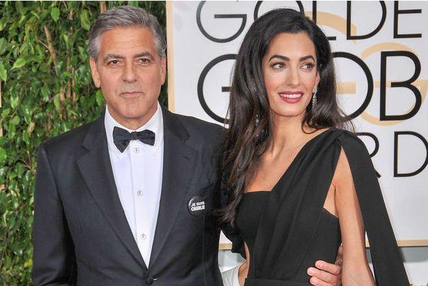 George et Amal Clooney sur le tapis rouge des Golden Globes le 11 janvier à Los Angeles