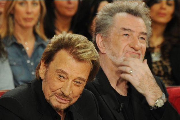 Johnny Hallyday et Eddy Mitchell en 2014.