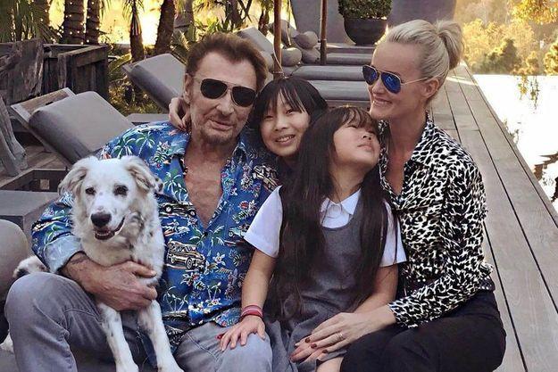 Johnny et Laticia Hallyday avec leurs filles Joy et Jade, en mars 2017.