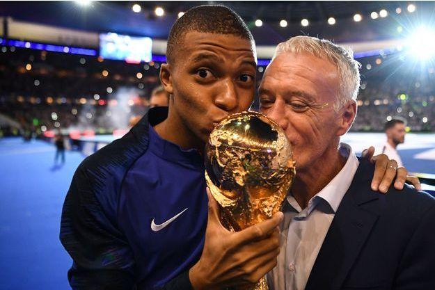 Kylian Mbappé et Didier Deschamps ici le 9 septembre au Stade de France pour fêter leur victoire en Russie.