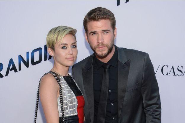 Miley Cyrus et Liam Hemsworth, le 8 août 2013 à Los Angeles.