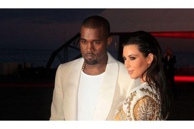Kanye West et Kim Kardashian, les futurs parents, sur une photo prise en mai dernier à Palm Beach.