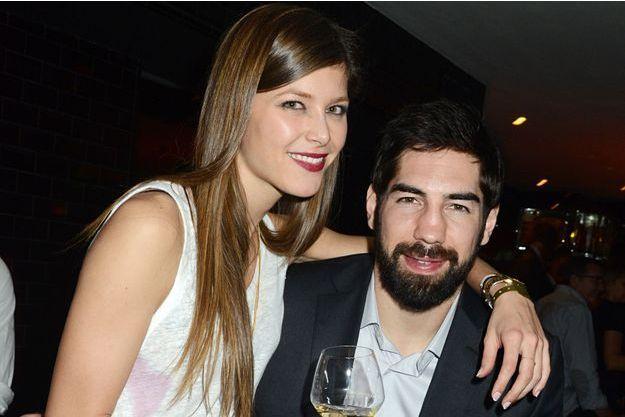 Nikola Karabatic et sa compagne à Paris le 27 janvier 2014.