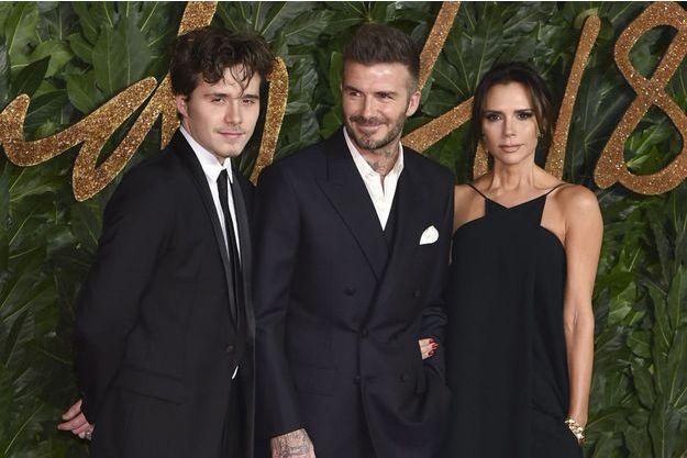 Brooklyn Beckham avec ses parents David et Victoria à la soirée British Fashion Awards à Londres, le 10 décembre 2018