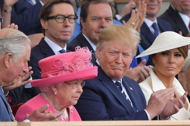 La Reine, Donald Trump et son épouse, Melania, lors du 75e anniversaire du Débarquement, à Portsmouth, le 5 juin.