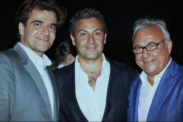 Ata Ahsani (à dr.) et ses fils Saman et Cyrus.