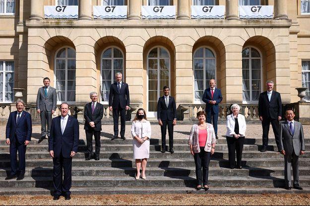 Les ministres du G7 Finances : Paolo Gentiloni (commissaire européen), Paschal Donohoe (président de l'Eurogroup), David Malpass (président de la Banque mondiale), Daniele Franco (ministre des Finances, Italie), Bruno Le Maire (ministre des Finances, France), Chrystia Freeland (ministre des Finances, Canada), Rishi Sunak (Chancelier de l'Echiquier), Kristalina Georgieva (directrice générale du Fonds monétaire international), Olaf Scholz (ministre des Finances, Allemagne), Janet Yellen (secrétaire au Trésor, Etats-Unis), Mathias Cormann (secrétaire général de l'OCDE) et Taro Aso (ministre des Finances, Japon).