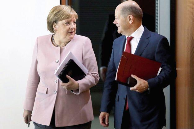 La chancelière allemande, Angela Merkel, et son ministre des Finances, Olaf Scholz.